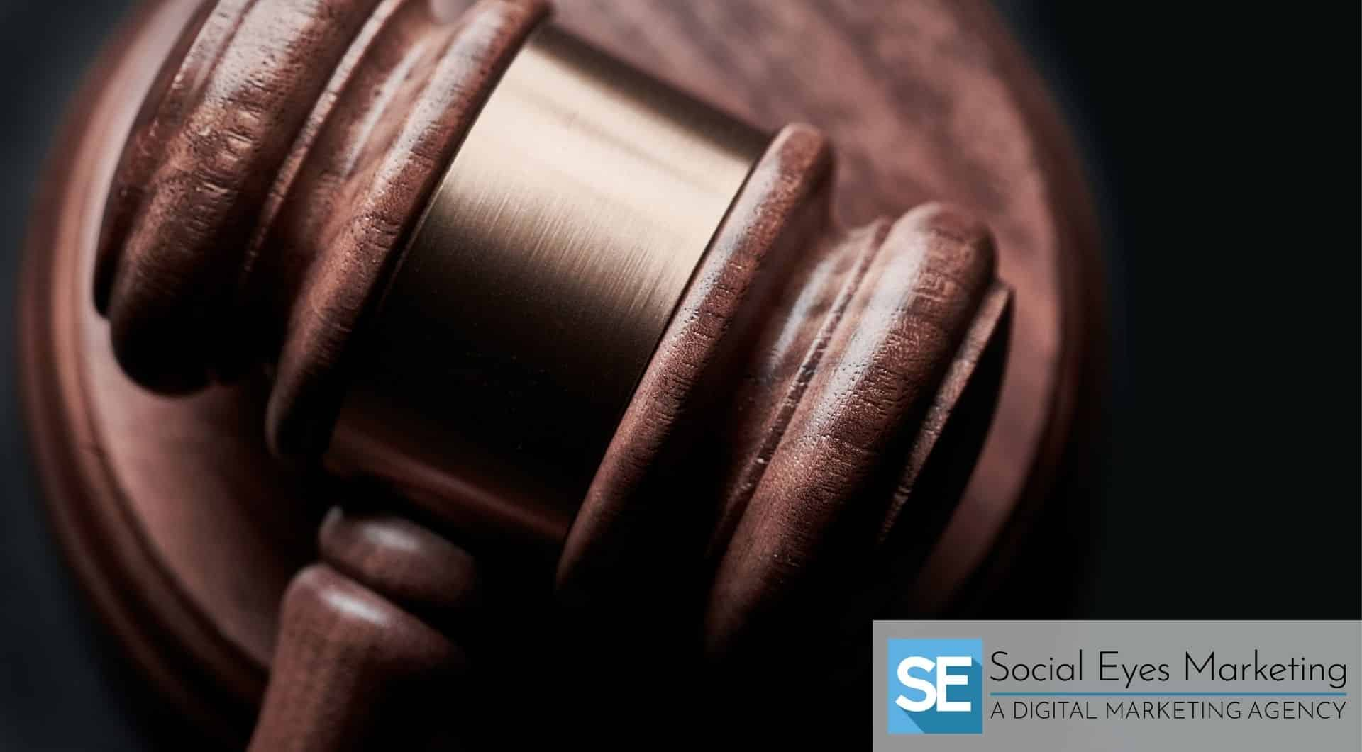 Wooden gavel on a matching block on a black background